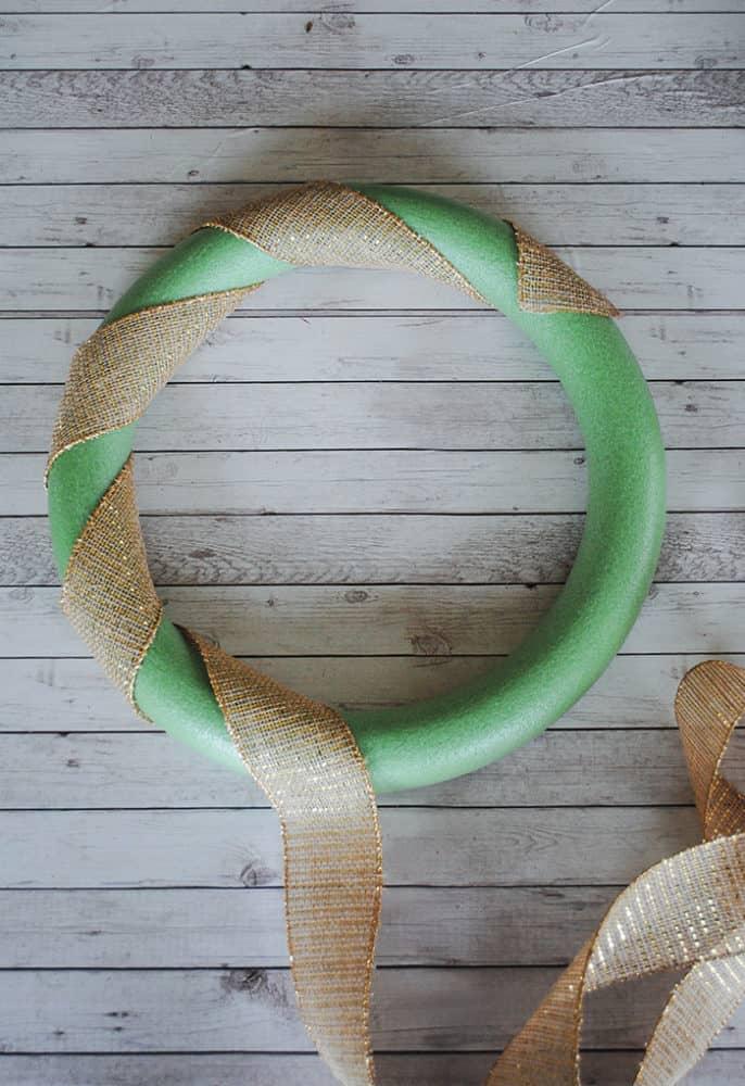 adding ribbon to wreath